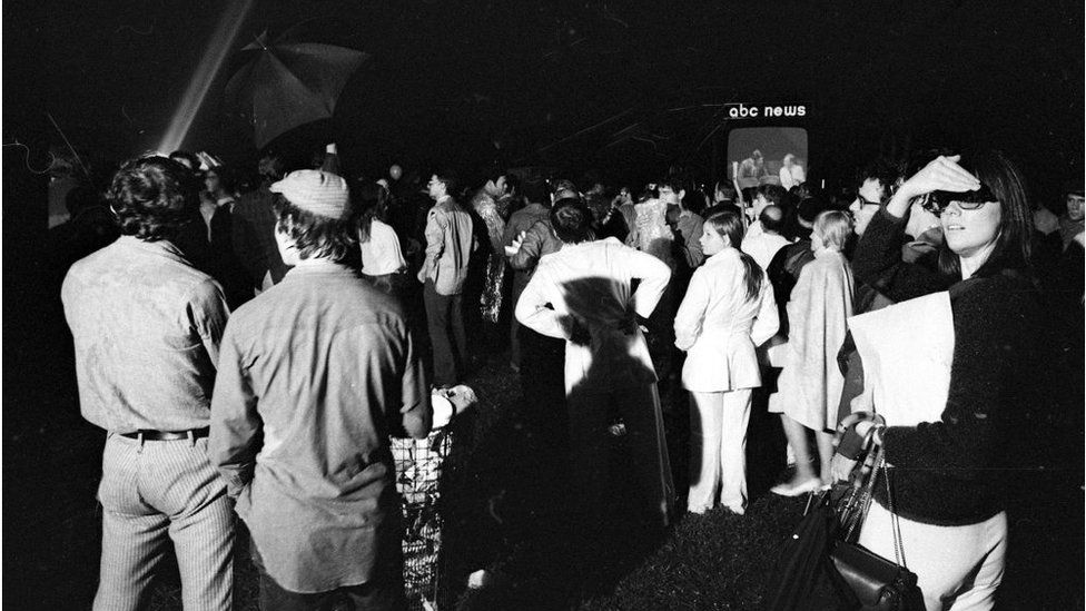Spectators gather at Central Park in New York, New York to watch reports of the Apollo 11 moon landing on one of the three giant television screens set up by the major networks on July 20, 1969