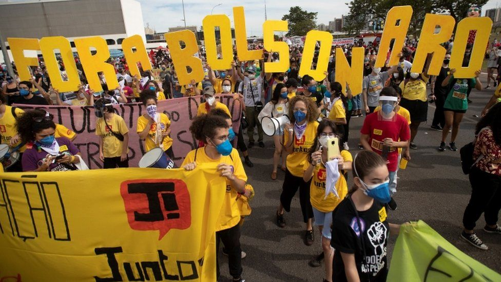 Opponents of Brazilian President Jair Bolsonaro attend a protest against his government in Brasilia, Brazil, 29 May 2021