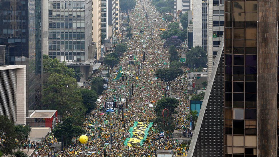 "Demonstrators fill Paulista Avenue during a protest demanding the impeachment of Brazil""s President Dilma Rousseff in Sao Paulo on 13 March"