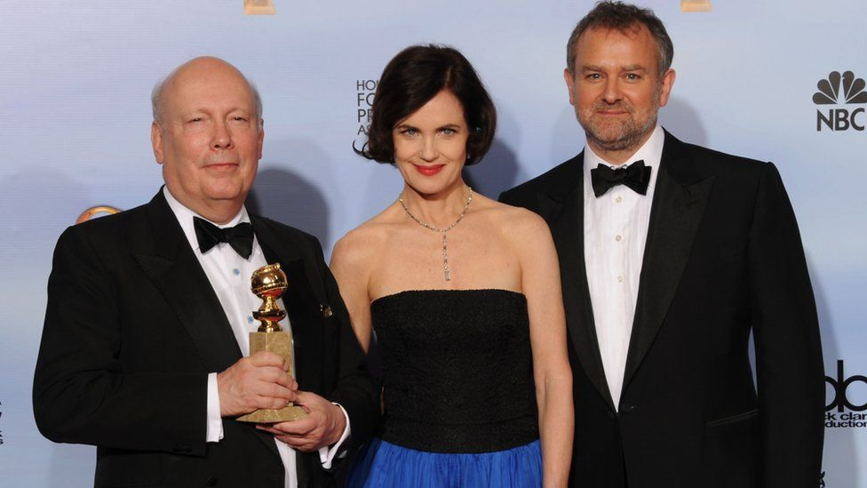 Julian Fellowes with actors Elizabeth McGovern and Hugh Bonneville at the 2012 Golden Globes