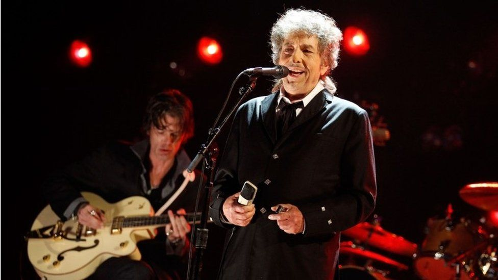 Dylan performing at the Hollywood Palladium in 2012