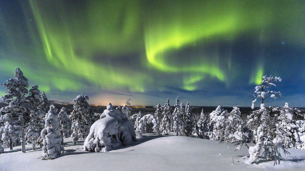 Finnish snow scene with Northern Lights