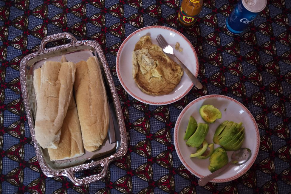 Bread with eggs for breakfast. Bamako, Mali, 5 February 2019.