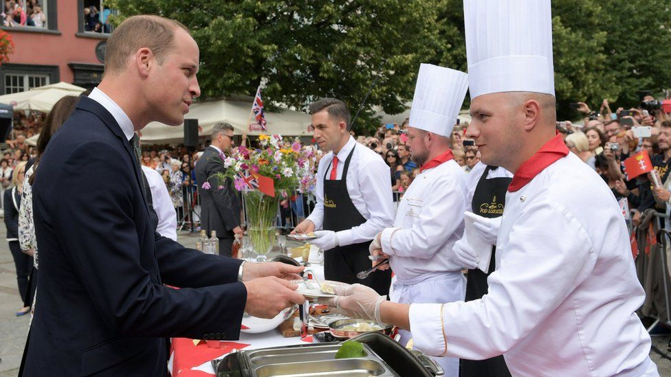 Prince William tastes traditional Polish dumplings on the second day of a tour of Poland