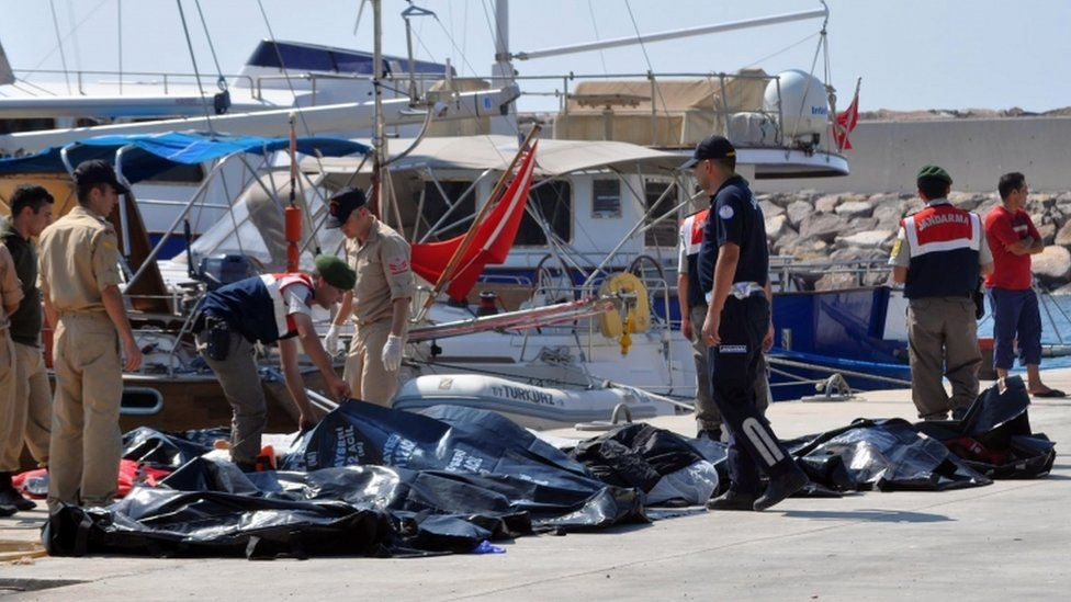 The bodies of those who died in the collision are retrieved by Turkish paramilitary police officers, 20 Sept