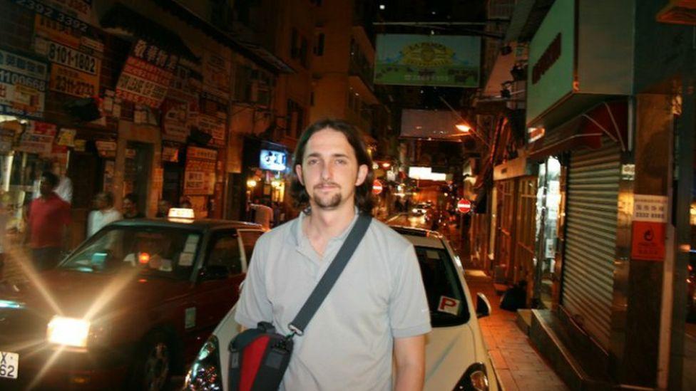 Jonathan Spollen on a busy Hong Kong street