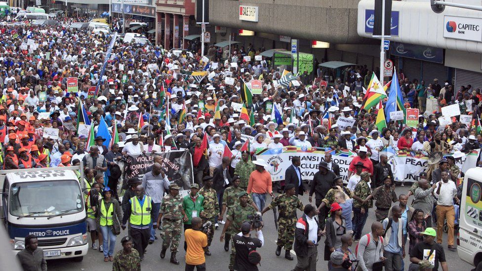 Thousands of people take part in the 'peace march' against xenophobia in Durban, South Africa, on April 16, 2015.