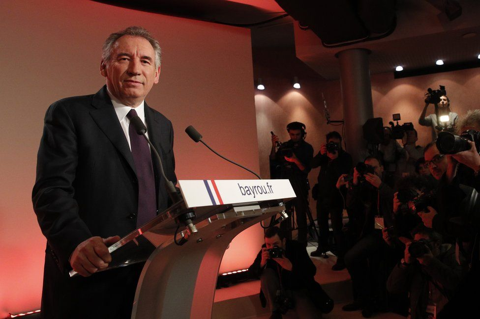 French centrist politician Francois Bayrou smiles before delivering his speech in Paris, 22 February