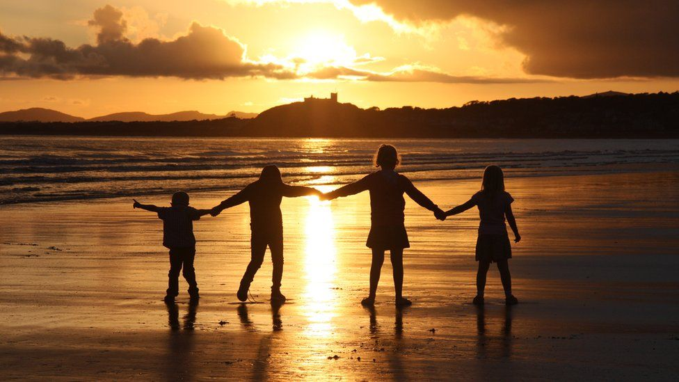 Alexandra Nash snapped her four children playing in the evening sun in view of Criccieth Castle