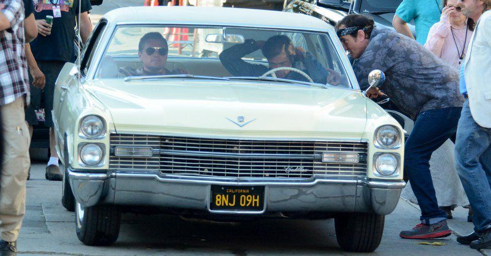 Leonardo DiCaprio and Brad Pitt filming with director Quentin Tarantino