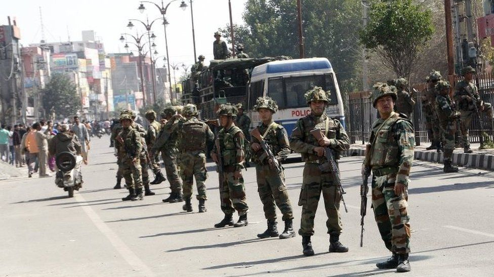 Indian Army soldiers stand guard at Rohtak, India, 22 February 2016