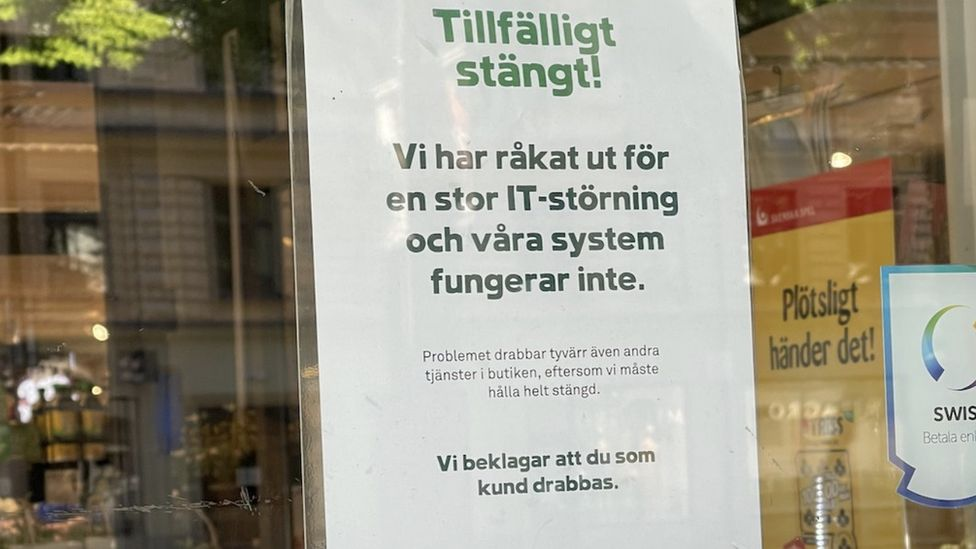 """A sign on one of the shut Coop shops in Sweden says the company has been hit by """"a large IT disturbance"""""""