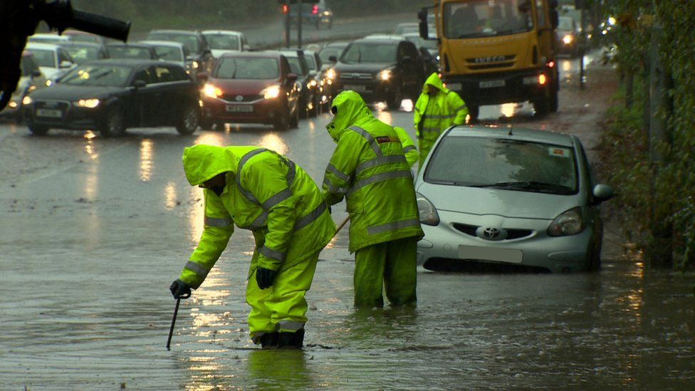 car caught in flood water on road
