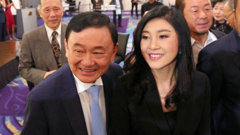 Former Thai prime ministers Thaksin Shinawatra (L) and his sister Yingluck Shinawatra (R)