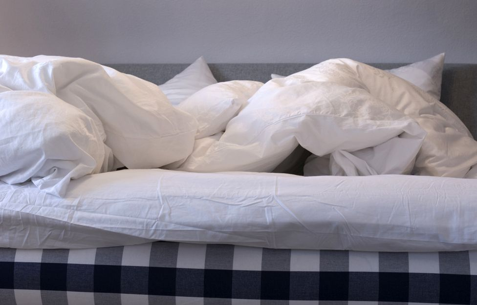 Duvet, unmade bed