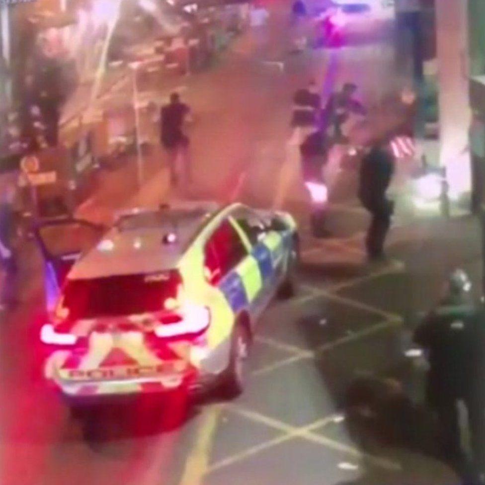 Police surround the men having shot them