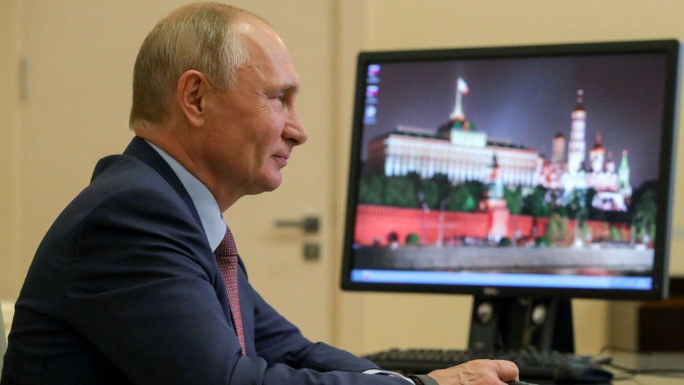 Russia's President Vladimir Putin during a video conference meeting with participants in the We Are Together nationwide volunteer campaign