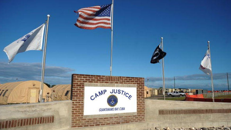 """A """"Camp Justice"""" sign near the high-tech, high-security courtroom"""