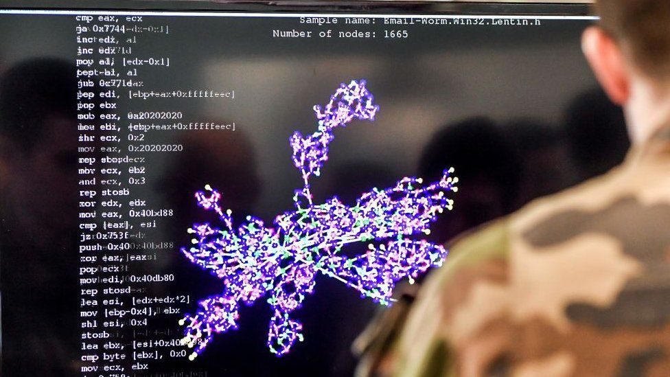 A member of the military specialised in cyber defence works on a computer during the 10th International Cybersecurity Forum in Lille on January 23, 2018