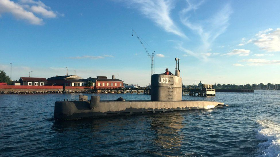 """The submarine """"UC3 Nautilus"""", with Kim Wall looking out of the top, is pictured in Copenhagen Harbour"""