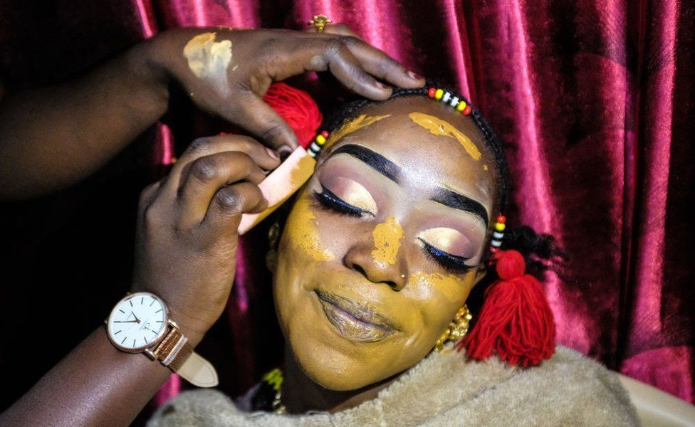 Dallifa Suleiman poses whilst having her make-up done before the traditional Islamic wedding in Kenya's Kibera slum - 7 August 2019