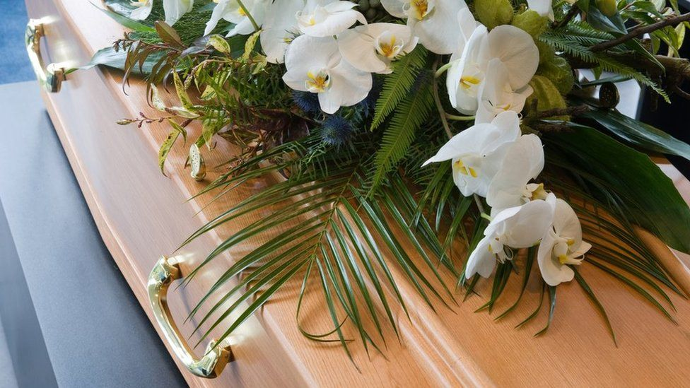 Coffin and flowers