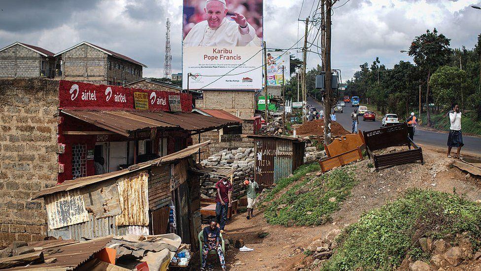 A poster welcoming Pope Francis to Kenya is pictured in the Kangemi slum on November 24, 2015 in Nairobi, Kenya.