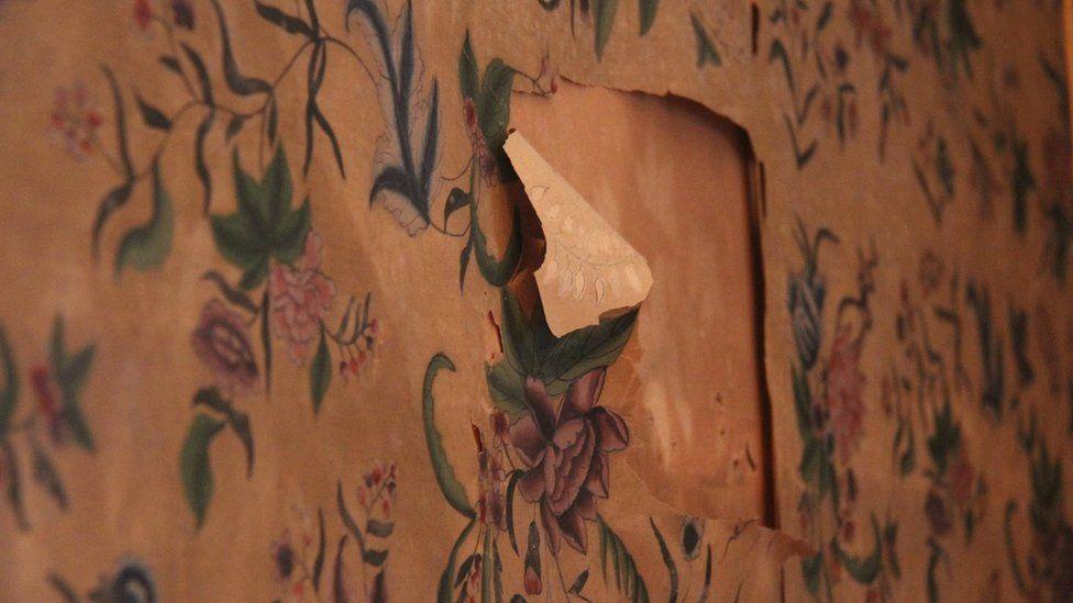 Ripped wallpaper