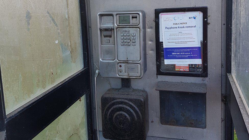 Inside phone box in Cumnock