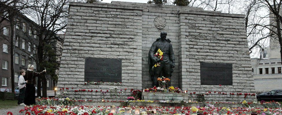 Flowers and candles decorate the area around the Bronze Soldier statue, a Soviet World War II memorial, 26 April 2007 in Tallinn