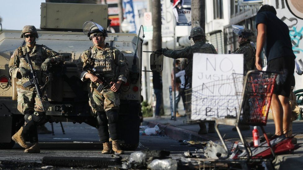 National Guard troops keep watch in the Fairfax District in California