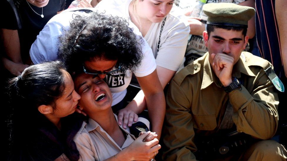 Family and friends, including Israeli soldiers, mourn during the funeral of Israeli soldier Omer Tabib, who was killed during cross-border fighting with Gaza