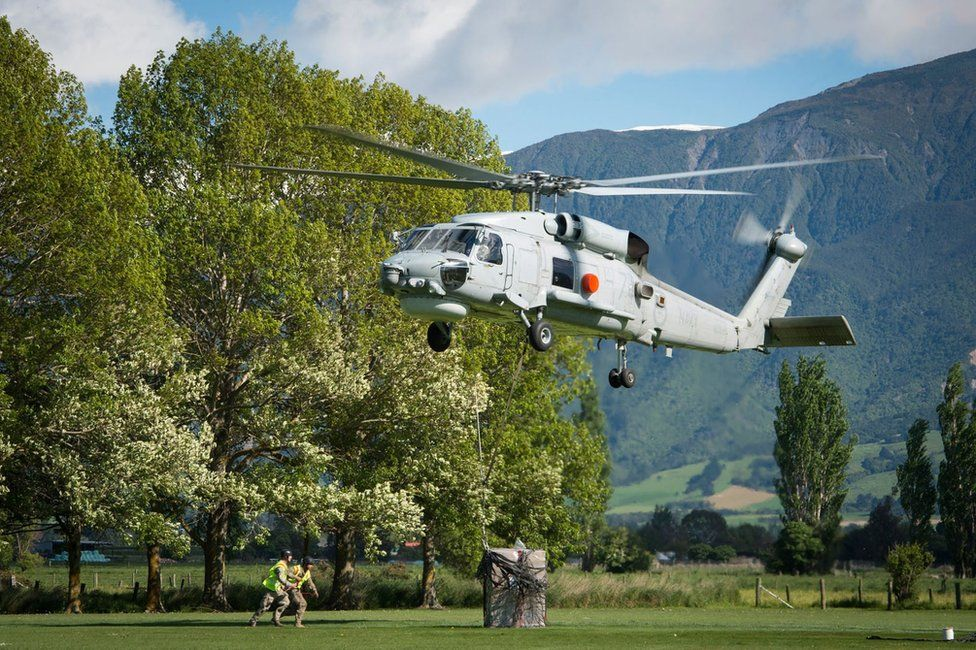A handout picture made available by the New Zealand Defence Force (NZDF) shows a Seahawk helicopter landing supplies in Kaikoura on 18 November 2016.