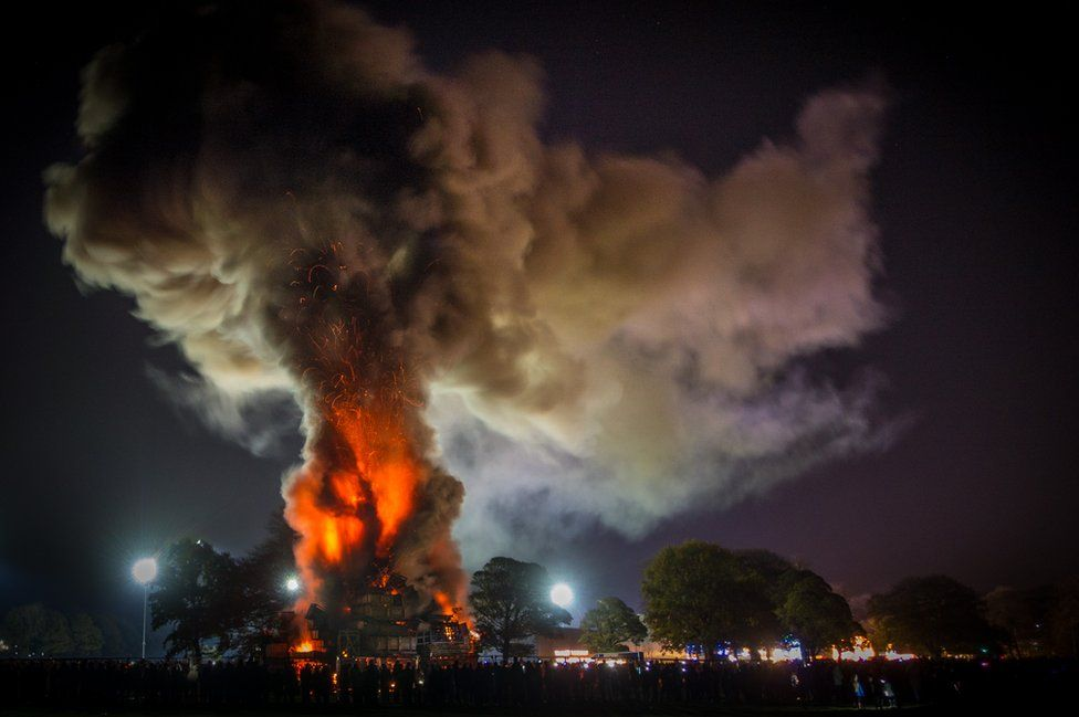 A bonfire with huge cloud of smoke over it