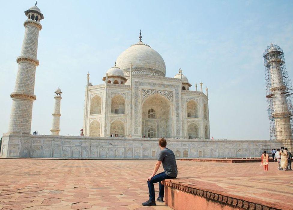 Facebook CEO Mark Zuckerberg sits facing the Taj Mahal during his visit to India in October 2015