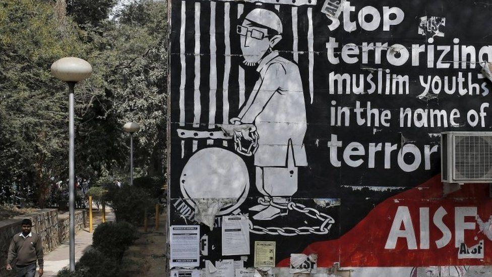 A man walks past graffiti inside the Jawaharlal Nehru University (JNU) campus in New Delhi, India, February 15, 2016.
