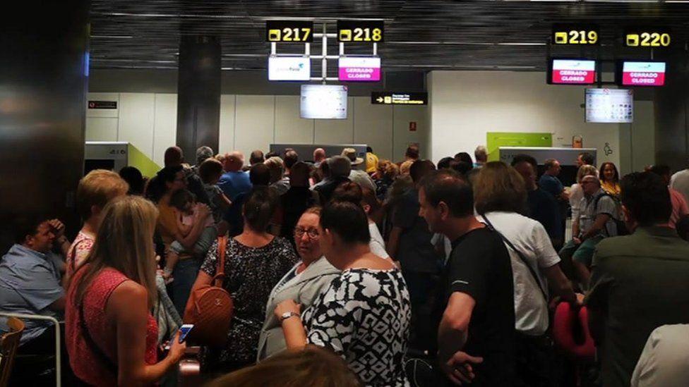 Passengers at Gran Canaria airport on Sunday