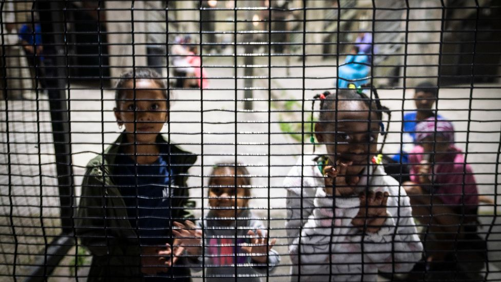 Children by a fence in Manenberg, Cape Town - South Africa