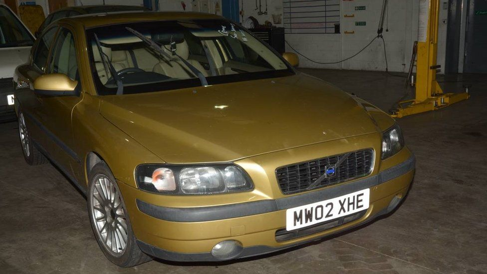 Gold-coloured Volvo