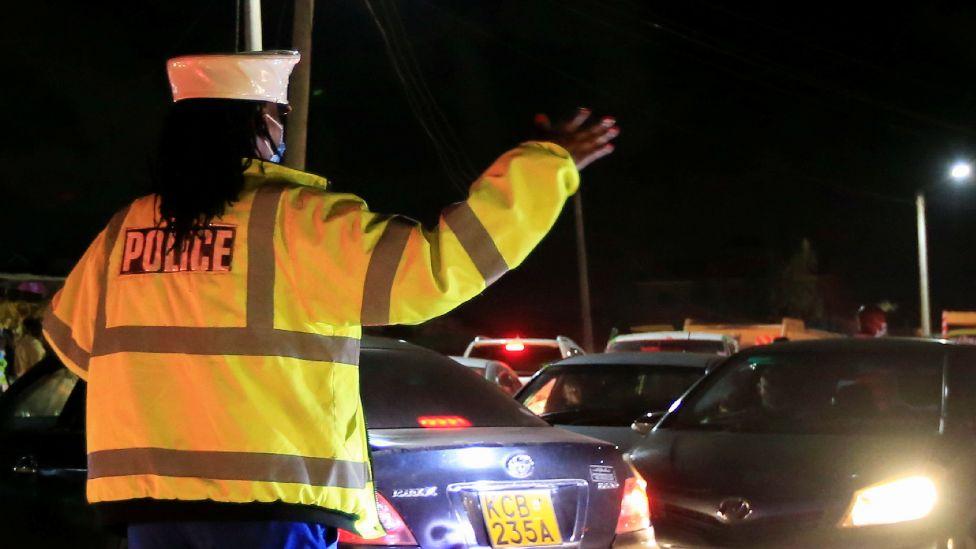 An officer at a curfew roadblock in Nairobi, Kenya