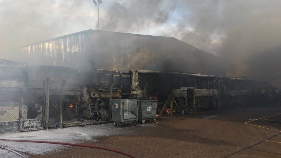 Burnt-out coaches at the garage after the fire