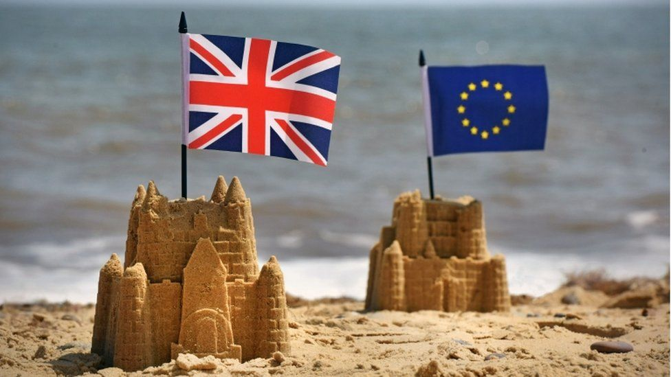 Sandcastles with Union Jack and EU flags