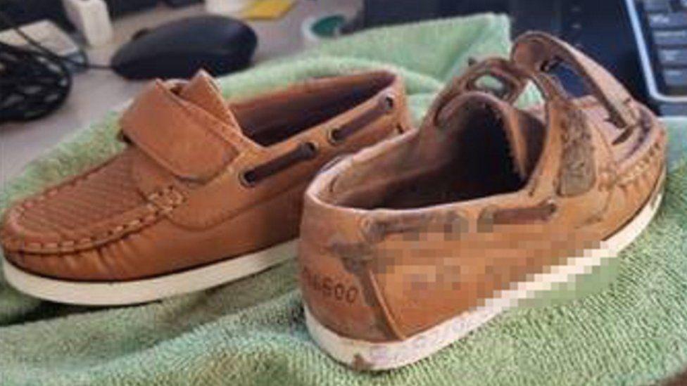 Migrant boy's shoes