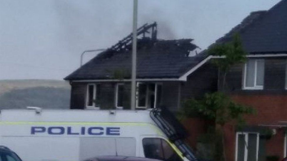 The badly damaged roof of the house following the fire