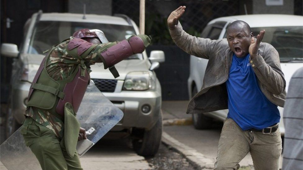 An opposition supporter yells out as he is beaten with a wooden club by riot police while trying to flee, during a protest in downtown Nairobi, Kenya Monday, May 16, 2016.