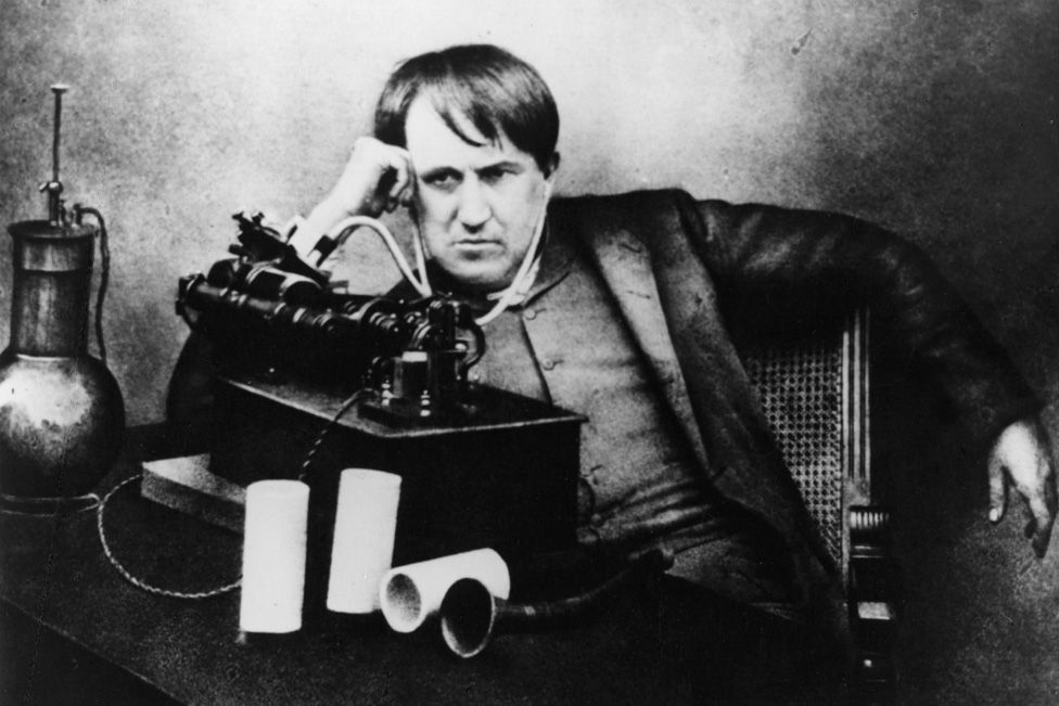 Thomas Alva Edison (1847 - 1931) American scientist, inventor and industrialist, after spending 5 continuous days and nights perfecting the phonograph, listening through a primitive headphone.