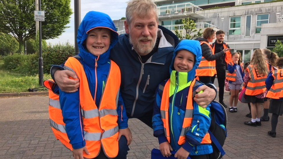 Andrew Powell with his sons Osian, 7, and Morgan, 5.