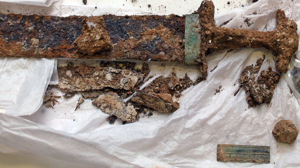 The sword and scabbard found in the burial