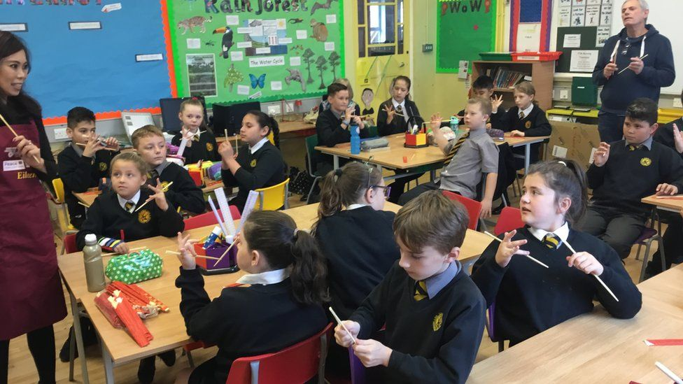 Pupils at Hart Memorial Primary School learning about chopsticks
