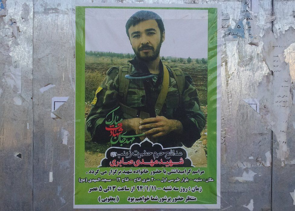 Poster showing dead Afghan fighter, in Mashhad, Iran